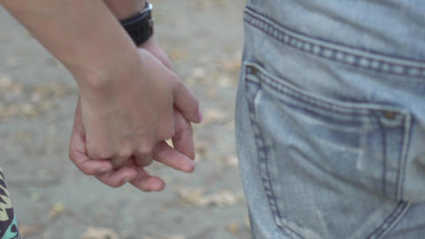 Boy And Girl Walking In The Park Holding Hands Real Time Live Action