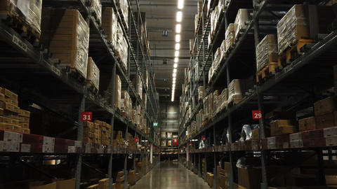 Rows of shelves with goods boxes in factory warehouse Footage