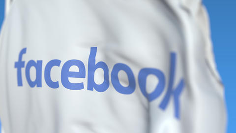 Waving flag with Facebook, Inc. logo, close-up. Editorial loopable 3D animation Live Action