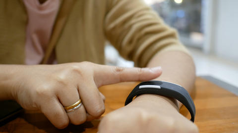 Hands of woman using smart watch for cyber and futuristic concept select focus shallow depth of fiel ライブ動画