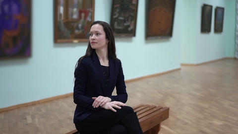 Elegant Beautiful Woman Looks at the Pictures in the Museum of Modern Art. Young Footage