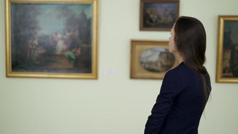 Young Woman Watching Works of Art Paintings on the Exhibition at City Art Live Action