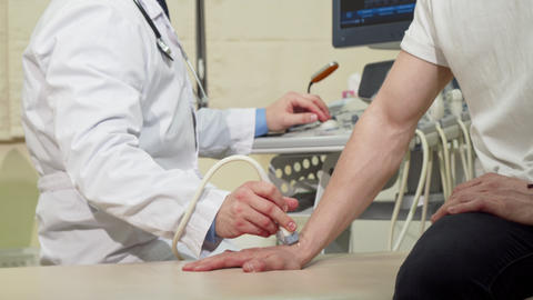 Man getting his wrist bones checked by doctor using ultrasound scanner Footage