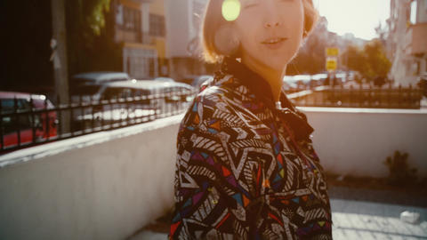 Fashionable concept, beauty girl with colorful jacket is smiling in urban Footage