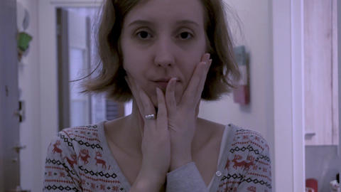 Sad, unhappy Caucasian woman in home. Beautiful stressful lonely girl portrait indoors Footage