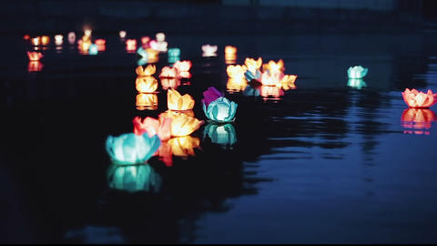 Running water flashlight. The glow of lanterns on the water at night. Romantic Footage