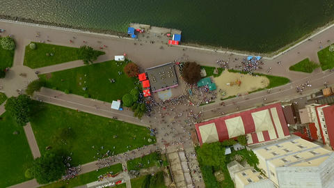 Air view. The dance festival takes place on a beautiful city promenade. The Live Action
