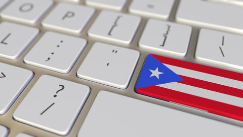 Key with flag of Puerto Rico on the computer keyboard switches to key with flag Live Action