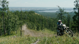 racer on a motorcycle rides to mountain Footage