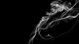 Curling Wisps of Smoke Rise from Bottom of Frame Footage