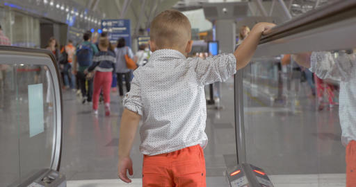 Little Boy Coming Off the Escalator Footage