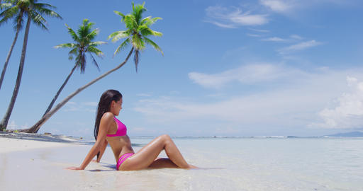 Beach vacation paradise suntan woman relaxing lying down sun tanning in tropics Footage