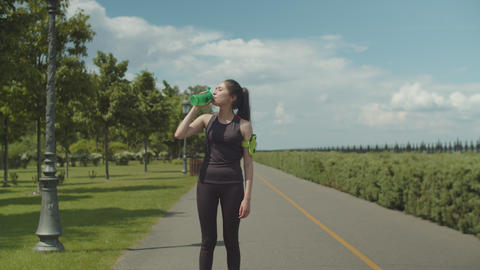 Fit woman drinking energy drink after hard workout Footage