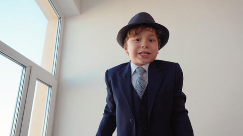 Boy Boss in Classical Suit and Hat Talk to Camera Footage