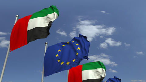 Flags of UAE and the European Union at international meeting, loopable 3D Footage