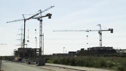 Tower Cranes above Neighborhood Community Construction Site Footage