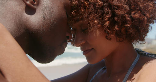 Couple embracing each other on beach in the sunshine 4k Live Action