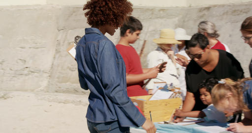 Side view of diverse volunteers preparing for beach cleanup on the beach 4k Live Action