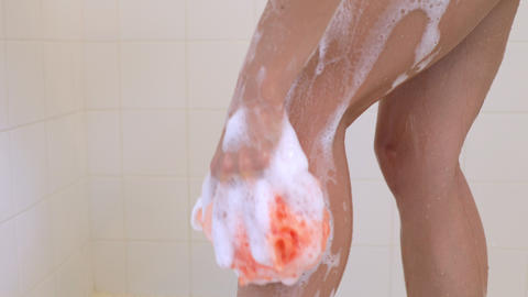 Attractive woman taking her morning shower Footage