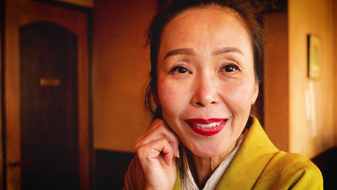 Elegant Japanese woman enjoying a coffee Footage