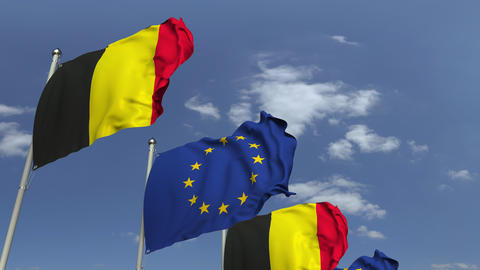 Flags of Belgium and the European Union against blue sky, loopable 3D animation Footage