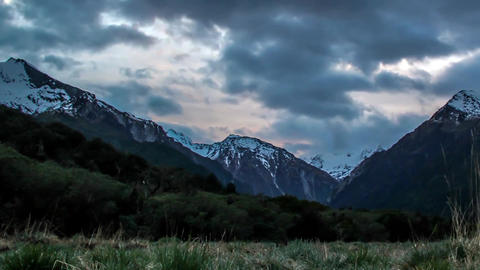 Mountains of New Zealand. Gloomy weather. Big, white and gray clouds are visible Live Action