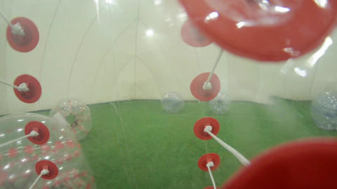 View from inside of soccer inflatable bubble of running person in amusement room Footage