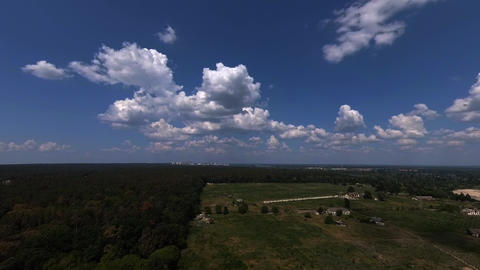 Clouds timelapse over the rural area GIF