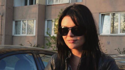 Young brunette girl in sunglasses dance at house on street in summer sunny Footage