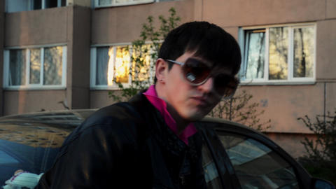 Brunette man in sunglasses shake head in camera on street in evening. Black Footage