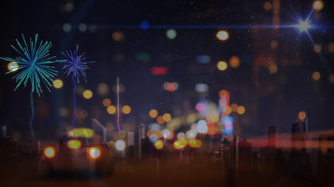 Cars driving towards fireworks on city road in the evening Animation
