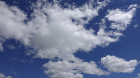 A big white cloud at blue sky background, Timelapse. Clouds in sunlight high in Footage