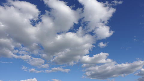 Time lapse of clouds at blue sky background. Beautiful white clouds in a clean Footage
