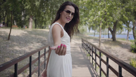 Portrait glamorous brunette young girl wearing sunglasses and long white summer Footage
