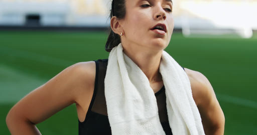 Female Athlete Wiping Sweat with Towel Footage