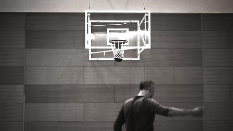 man plays basketball, old movie style Footage