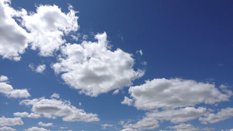 Sunlight passes through the white clouds hovering in the summer sky, Timelapse Footage