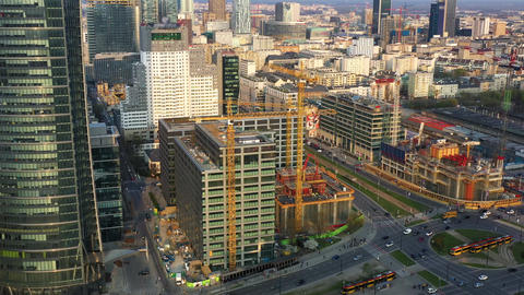 Aerial view of construction cranes and building construction in the center of Live Action