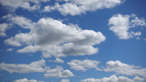 Beautiful white clouds moving fast high in the blue sky, Time-lapse. Sunny sky Live Action