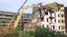 High Reach Demolition Excavator Tear Down Pieces of Building Live Action