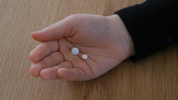 The child hand is holding pills, Live Action