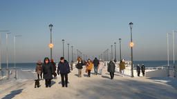 Gdansk, Poland. Baltic sea and strolling people. Pier in winter scenery Footage
