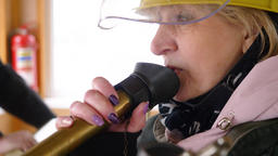 Close up woman speaking to loudspeaker on navigation on panel while shipping Footage