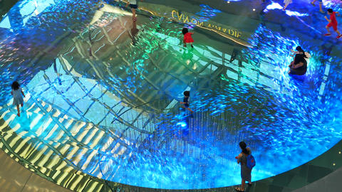 Kids play on Digital Light Canvas inside The Shoppes - Medium shot Footage