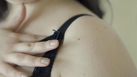 Close-up of an attractive girl touching her big breasts in black lace bra Footage