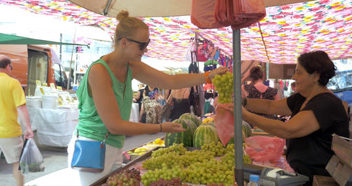Young Woman Choosing Grapes before Buying Footage