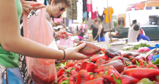 Choosing Red Peppers at Street Stall Footage
