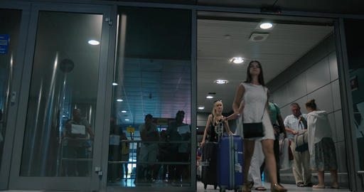 Travellers and People Meeting Them in Arrivals Hall Footage