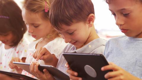 children using tablet computer Live Action