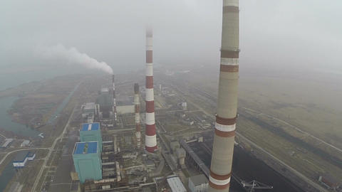 Power plant area and smoking pipes, aerial view Footage